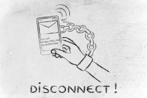 hand chained to a mobile with text Disconnect!!